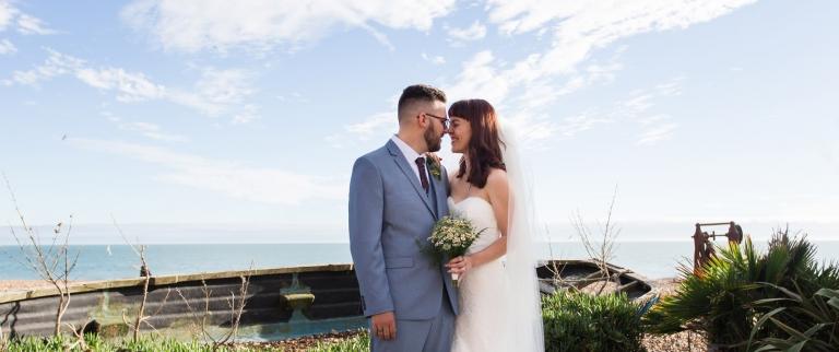 romantic brdie and groom photo by sea