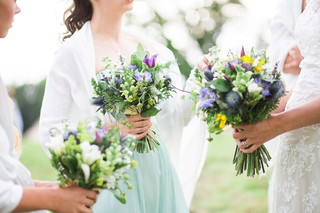 close up of wedding flowers held by bridesmaids in new Forest wedding by jenny owens photography