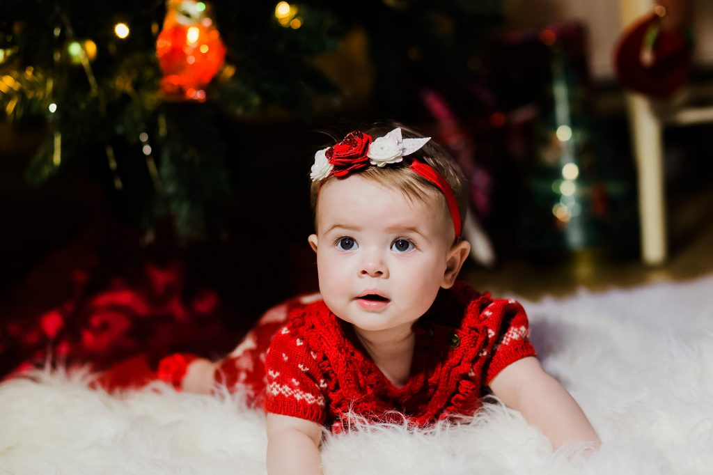 baby girl in red dress at christmas by jenny owens photography