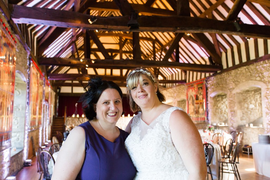 wedding planner in purple and dride posing for a photo at The Domus Beaulie