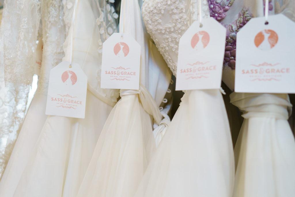 sass and grace bridal tags on wedding dresses