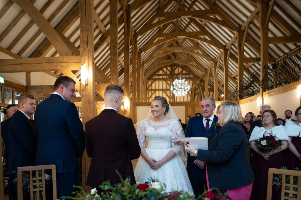 brdie meeting groom at the top of the aisle at ceremony room rivervale barn