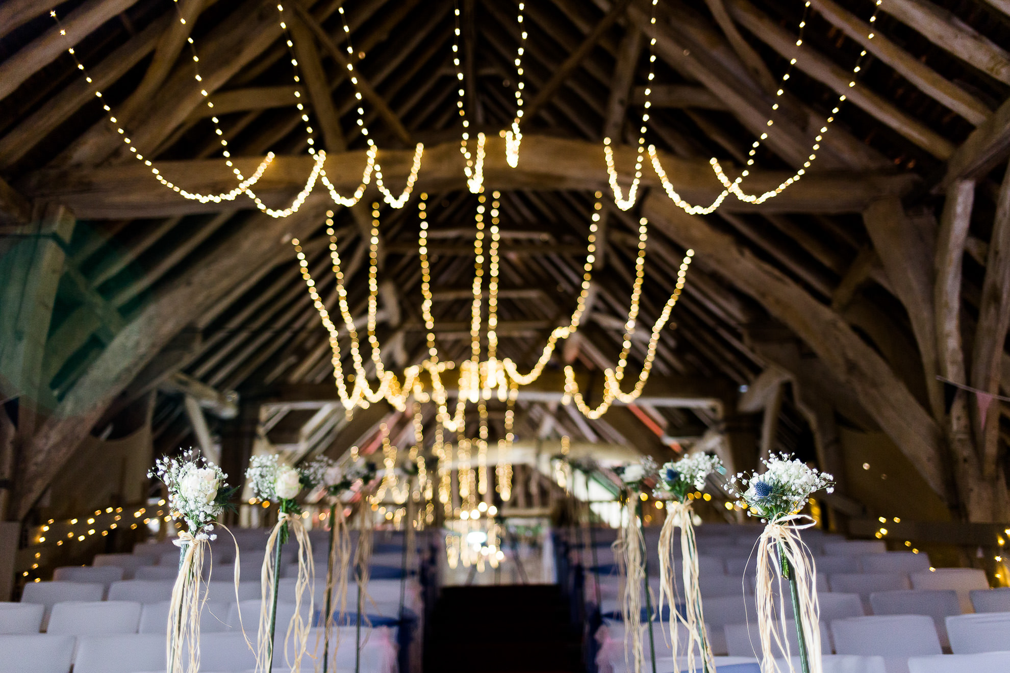 interior of the ceremony space at tichfield barn wedding vneue in hampshire