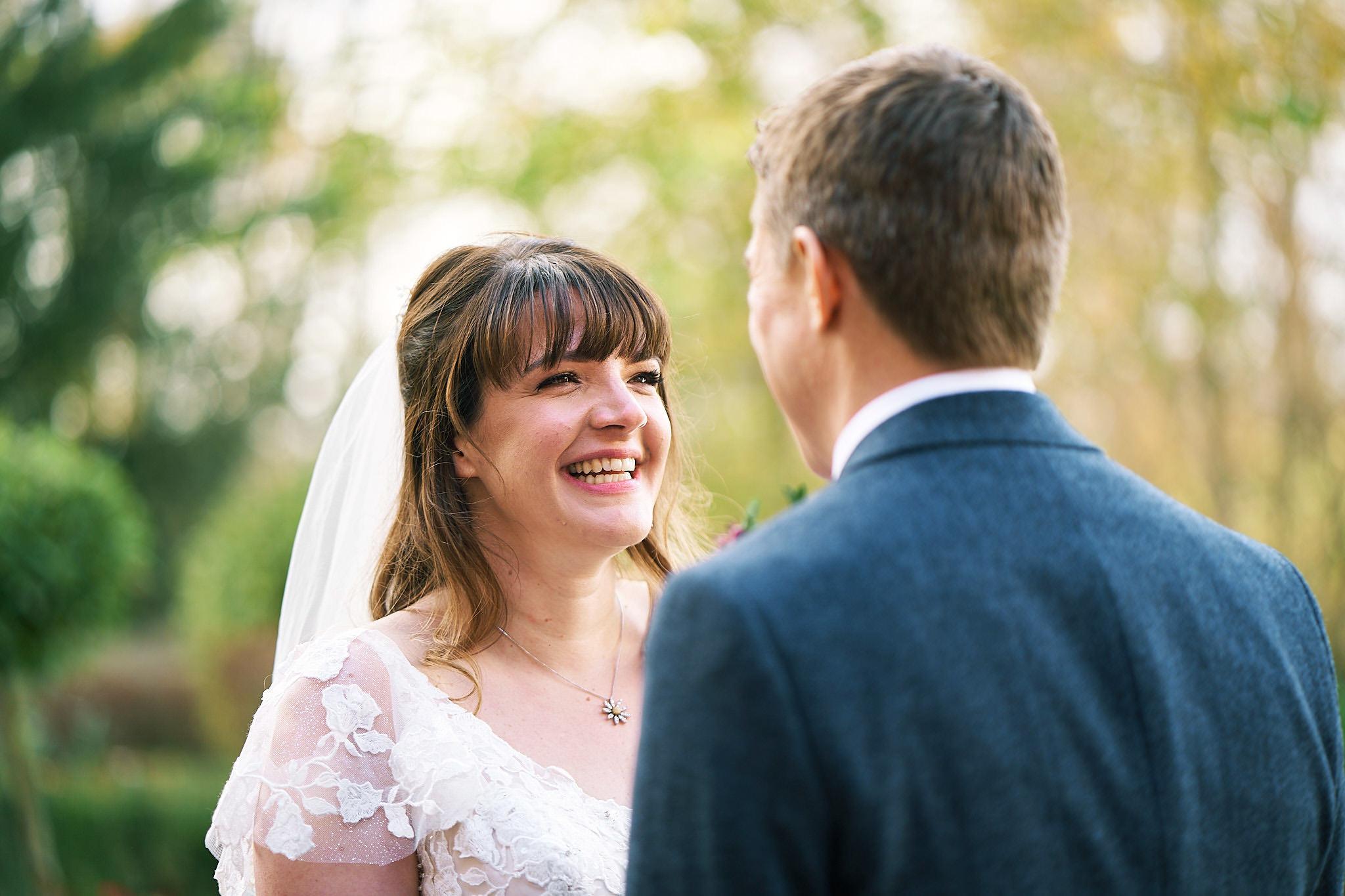 focus on brdie looking at her groom