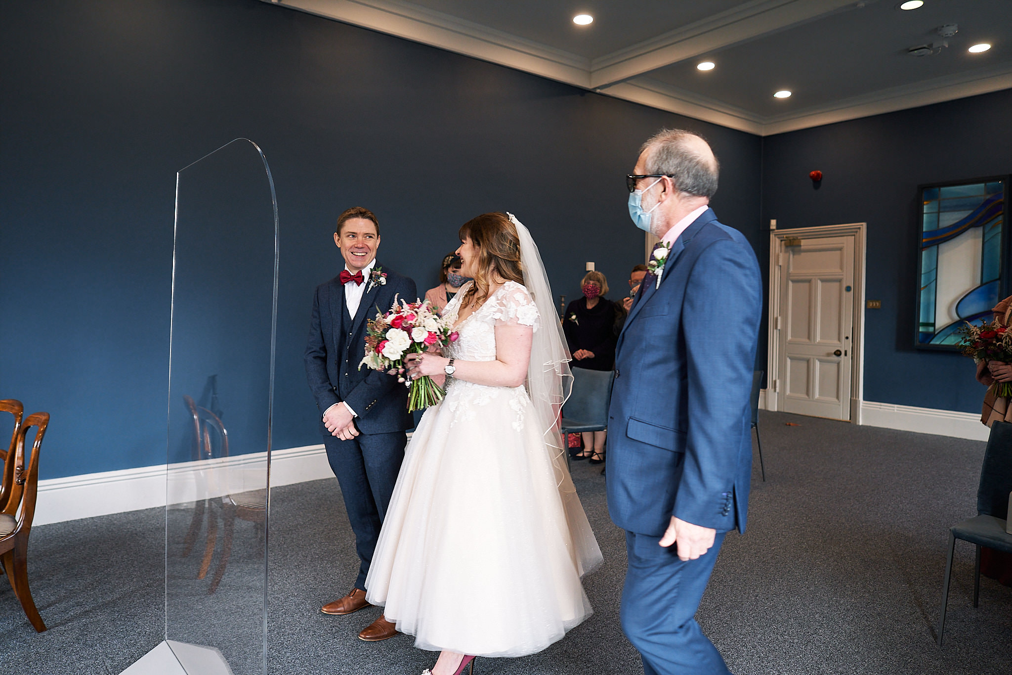 bride reaches her groom at winchester registry office wedding