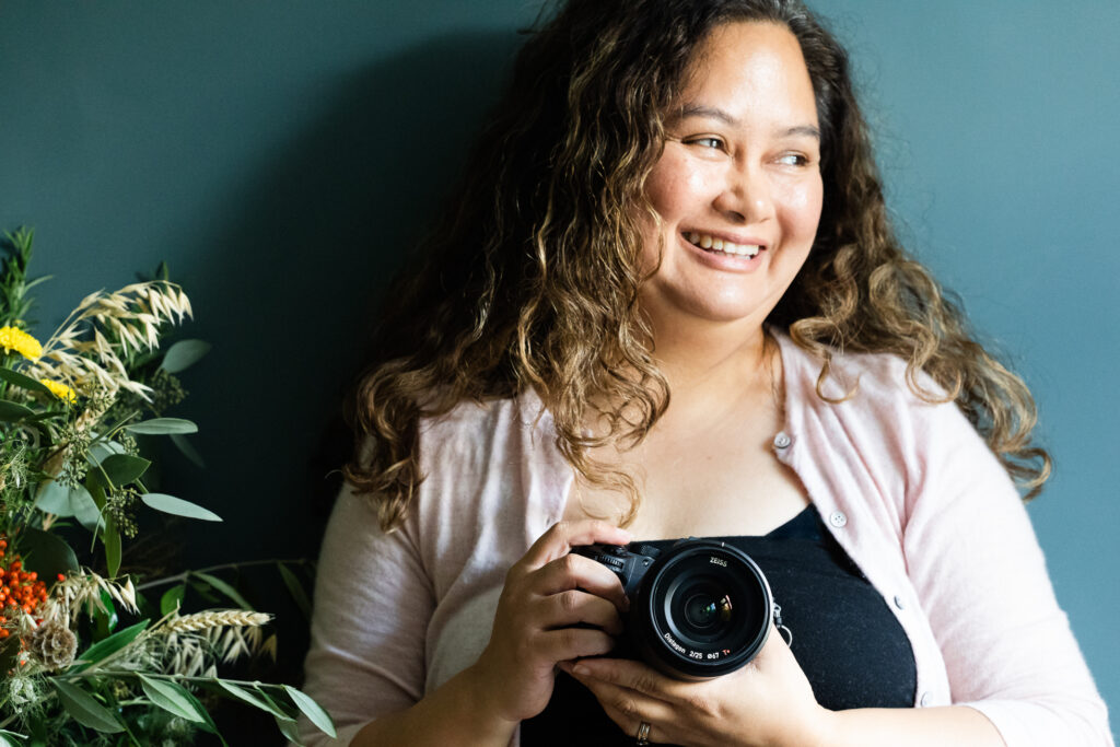 portrait of jenny owens photography holding a camera