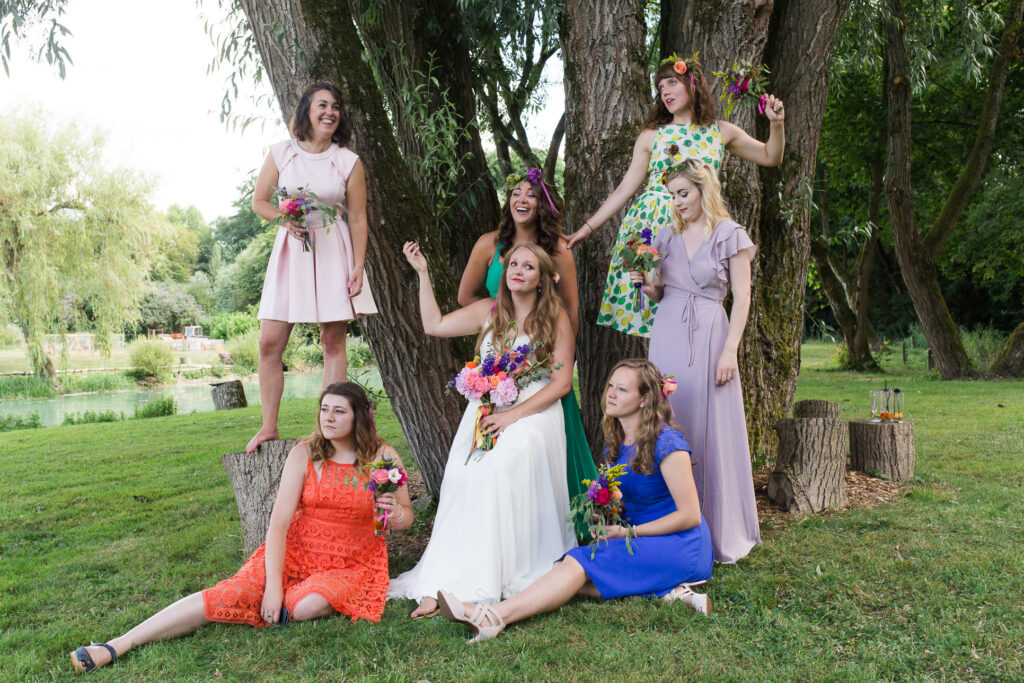 fun wedding posed photo of bride and her bridesmaids