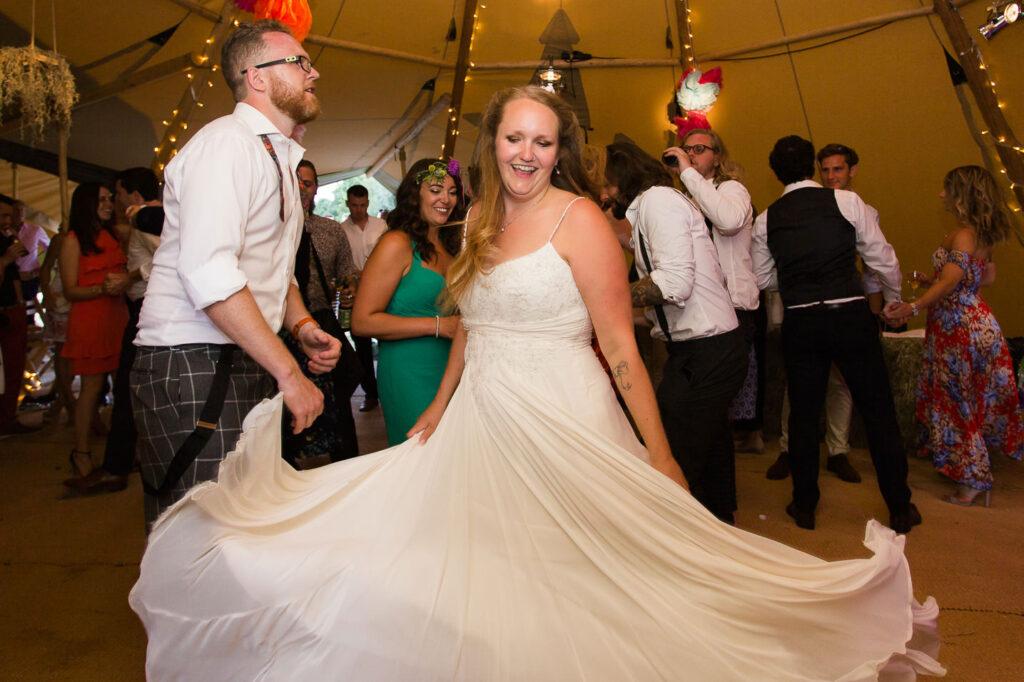 unposed dancing bride and groom on dancefloor
