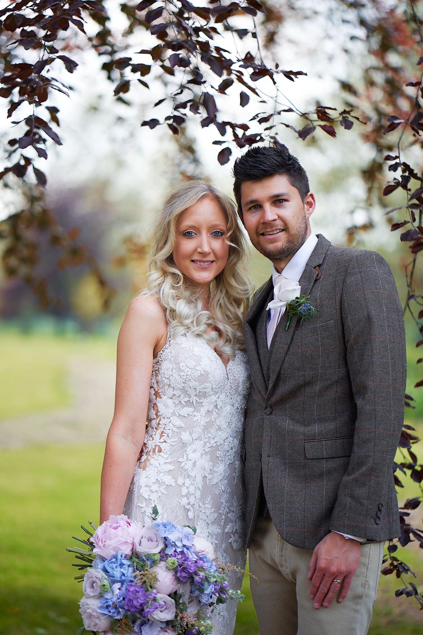 bride and groom portrait under tree at avington park