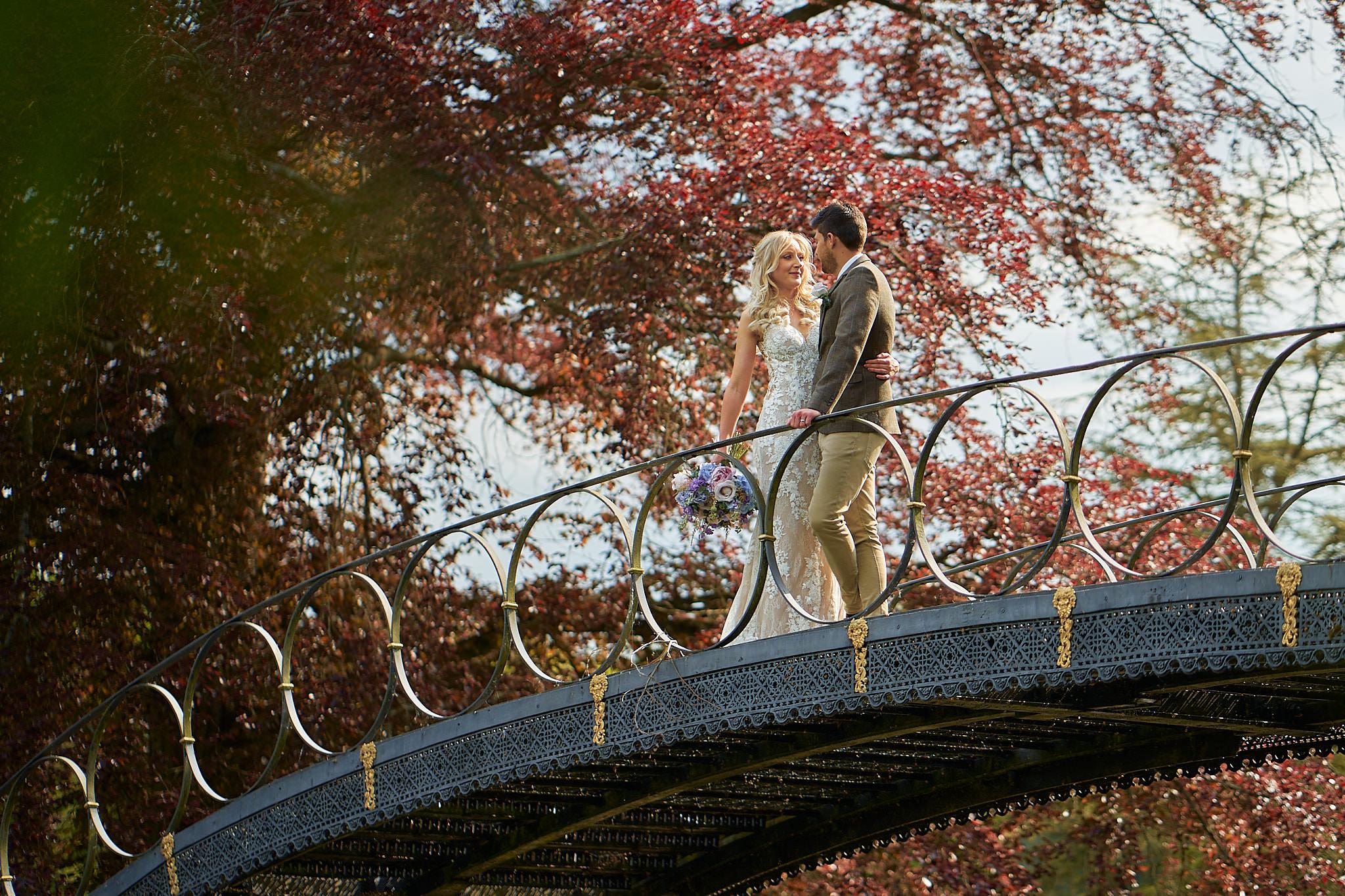 bride and groom at avington park bridge