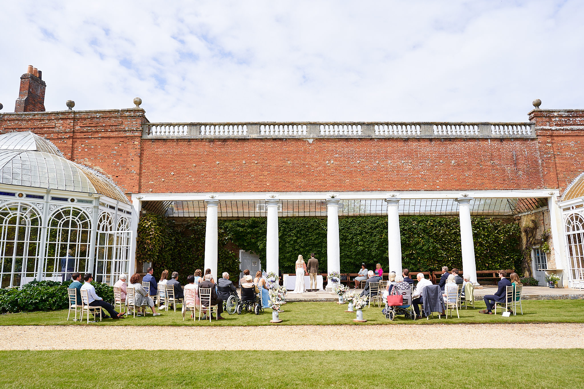 bride and groom at outdoor ceremony at Avington PArk