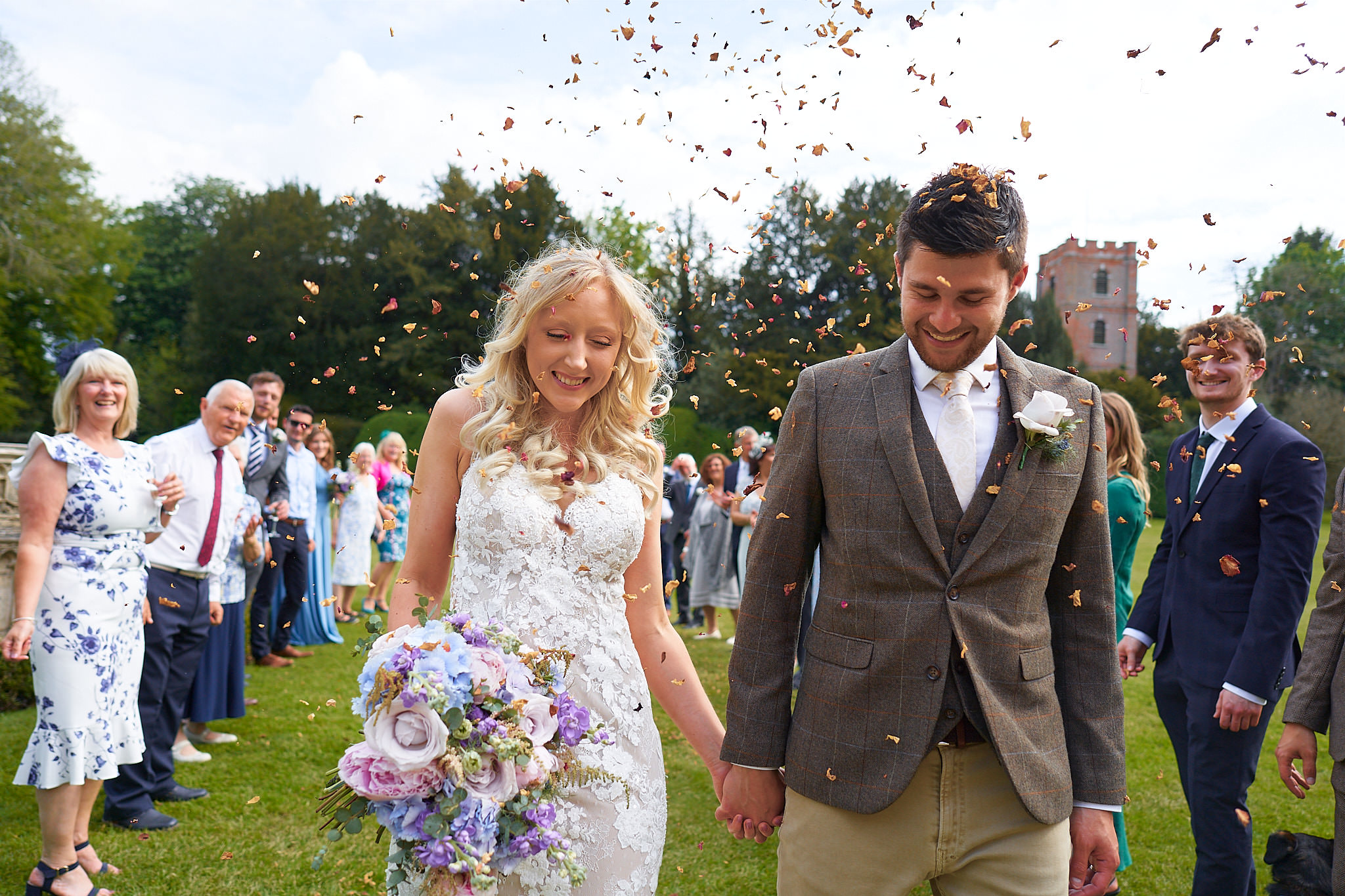 bride and groom with confetti outside Avington Park Manor House
