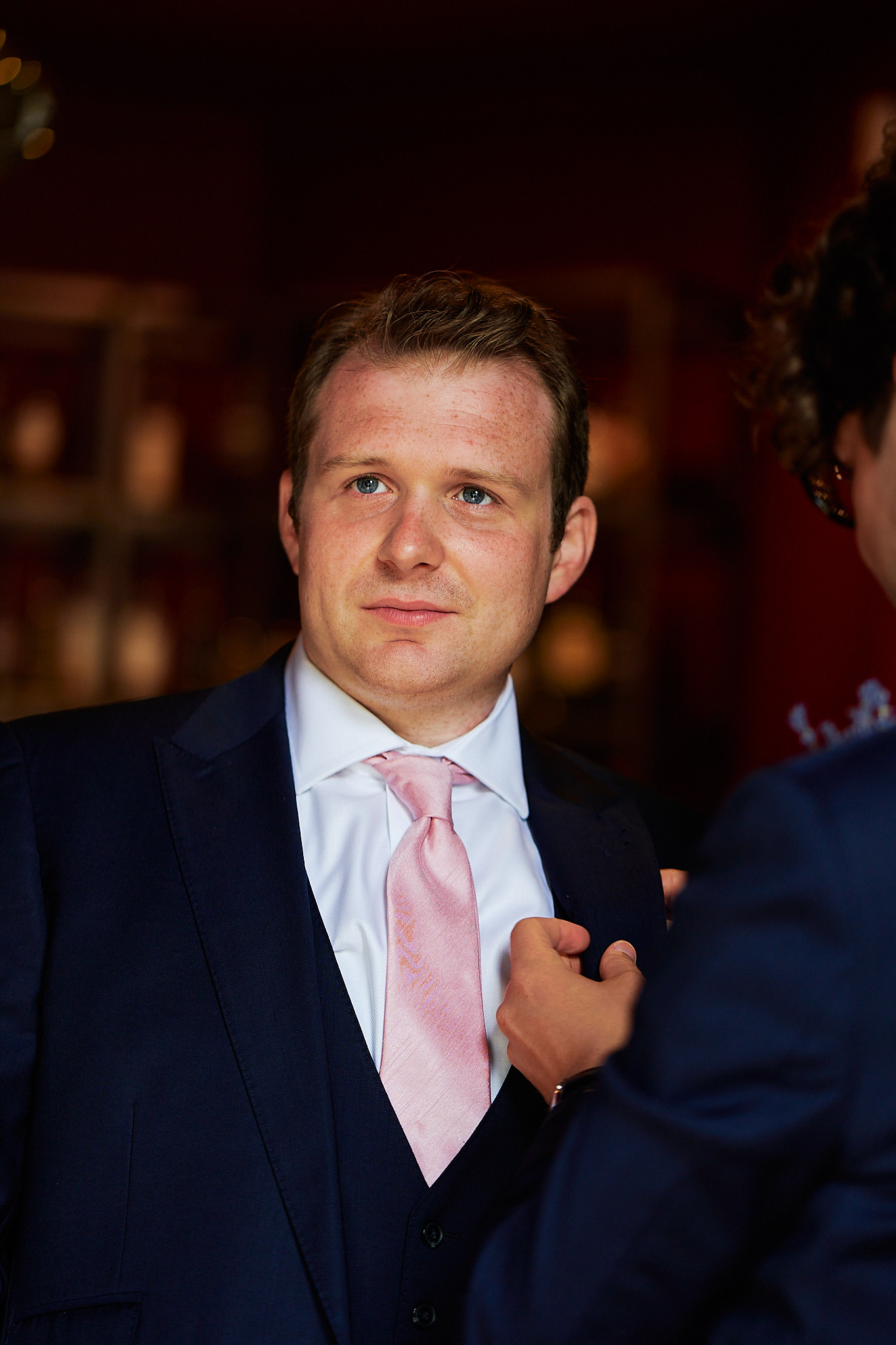 portrait of groom in bar