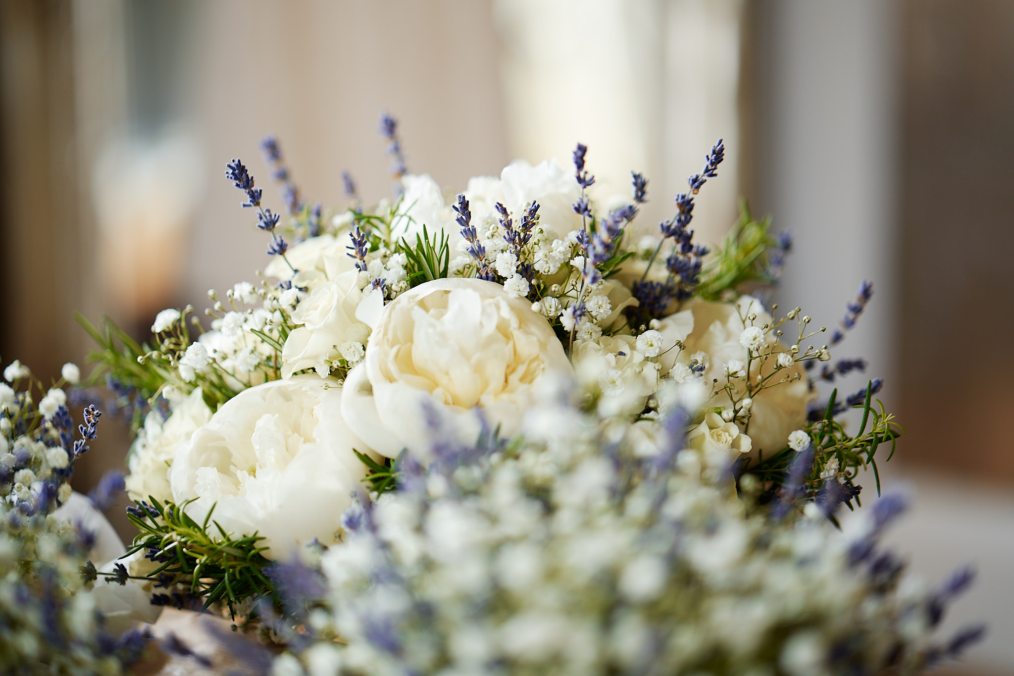 close up of bride's bouquet with peonies and lavander
