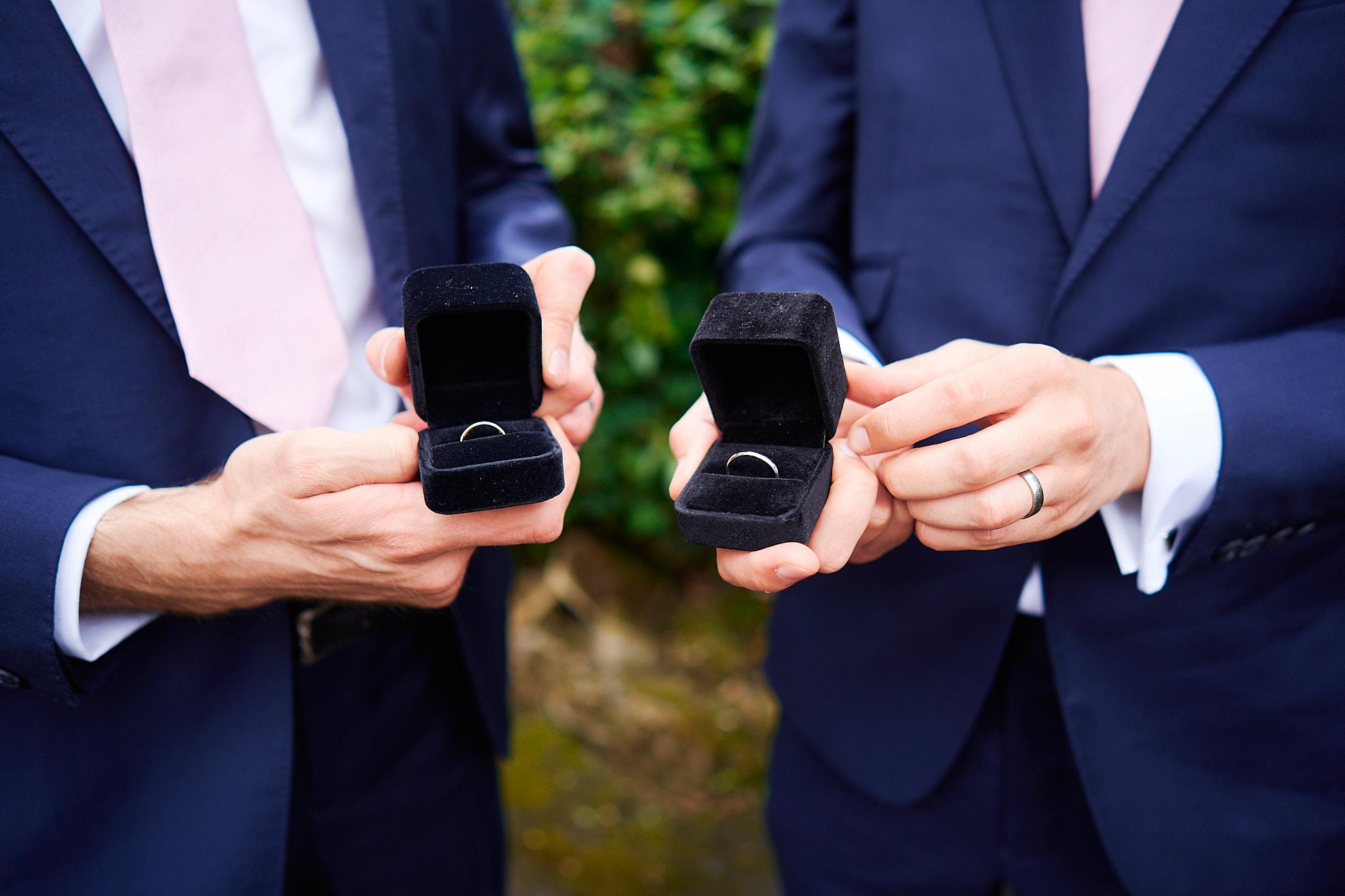 two best men holding the wedding rings at hotel du vin