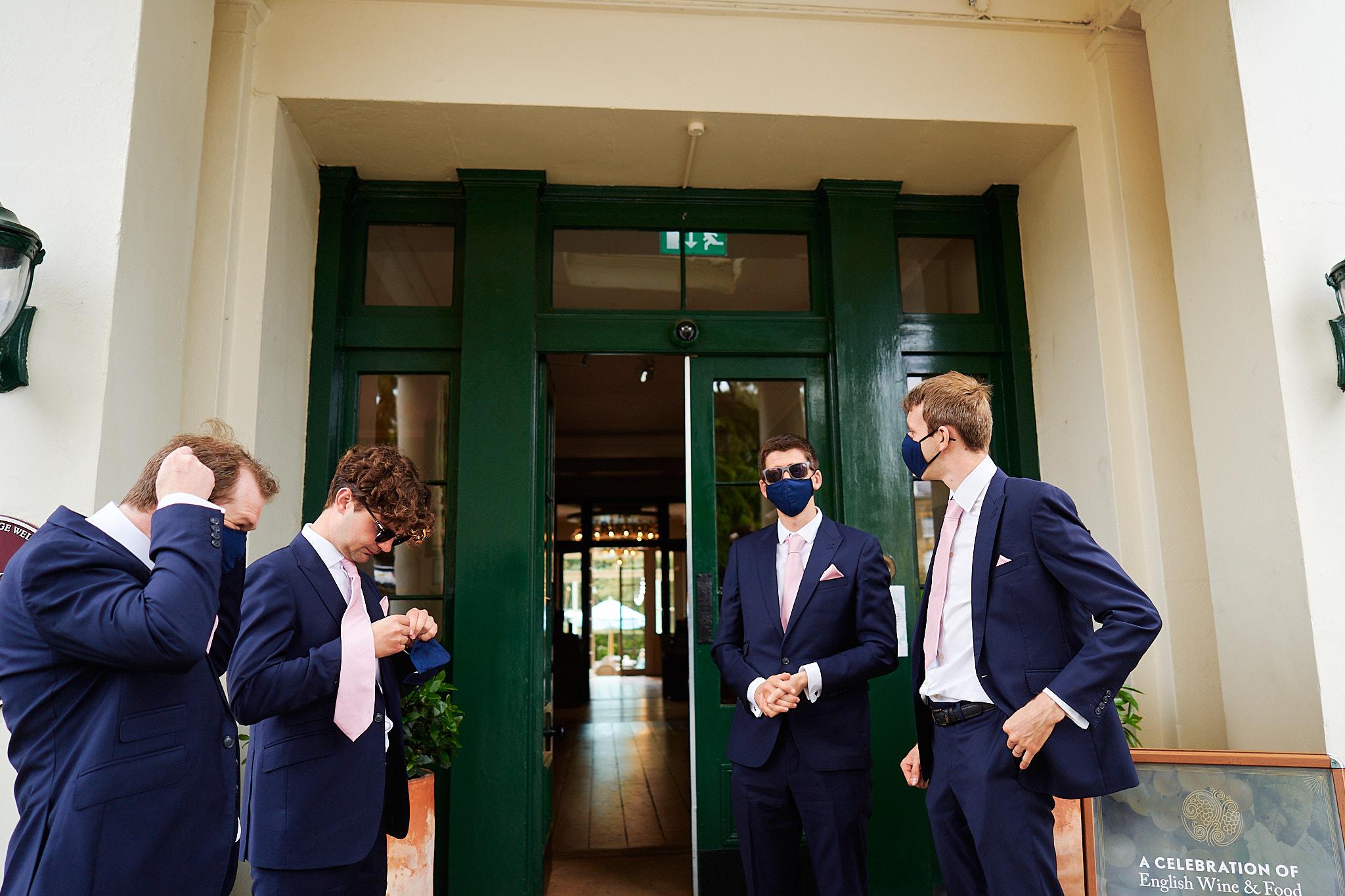 masking up before going in hotel du vin for summer wedding