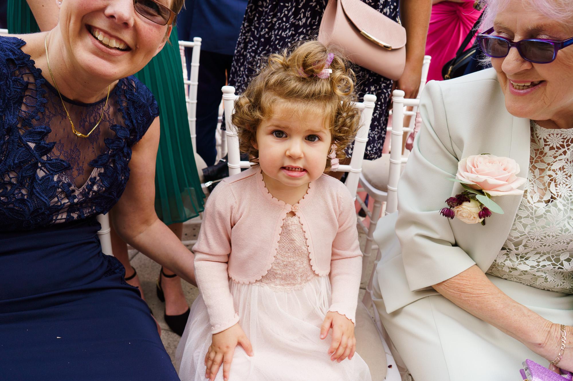 toddler in pink at wedding