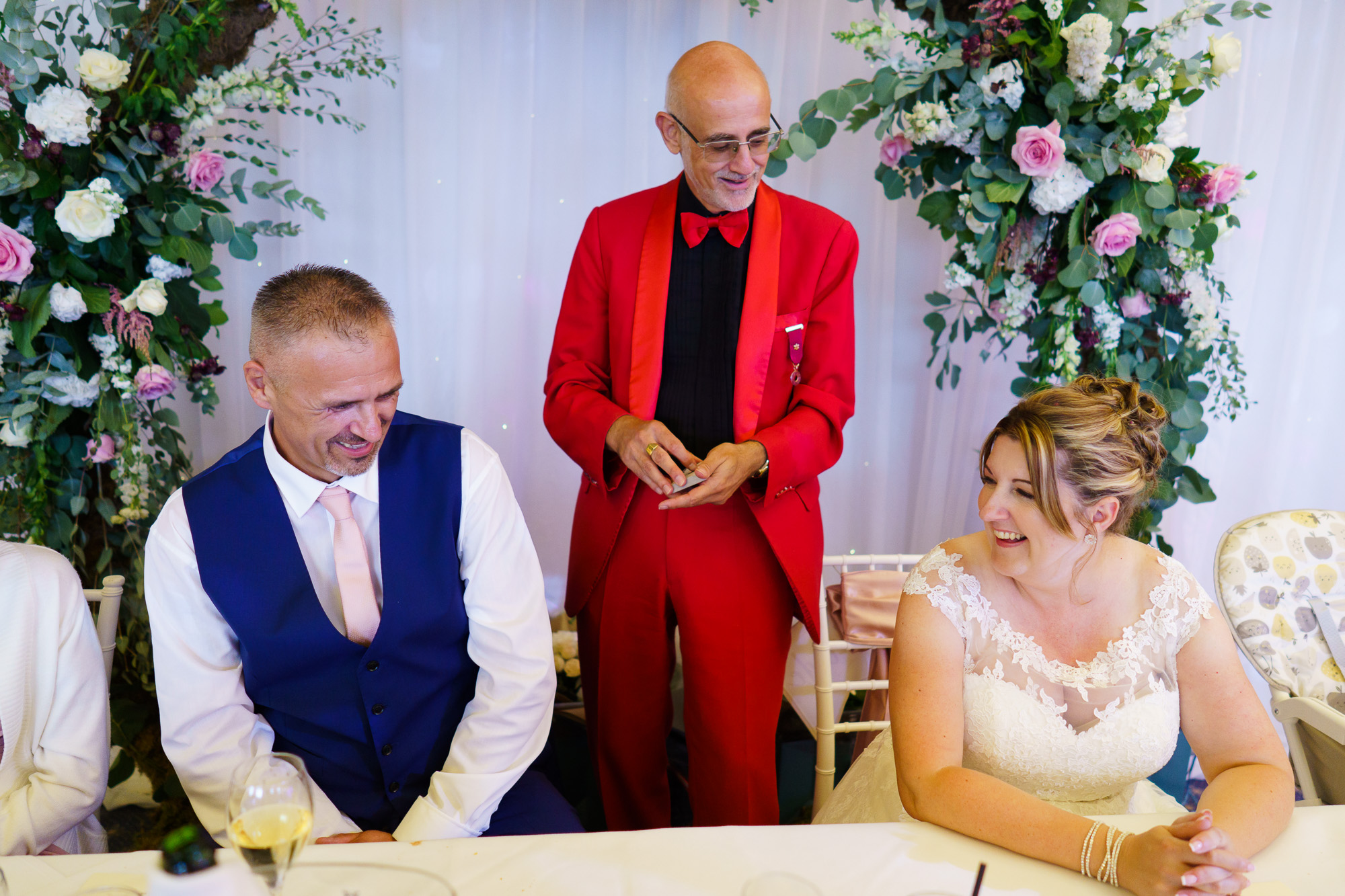 brdie and groom and magician at their wedding