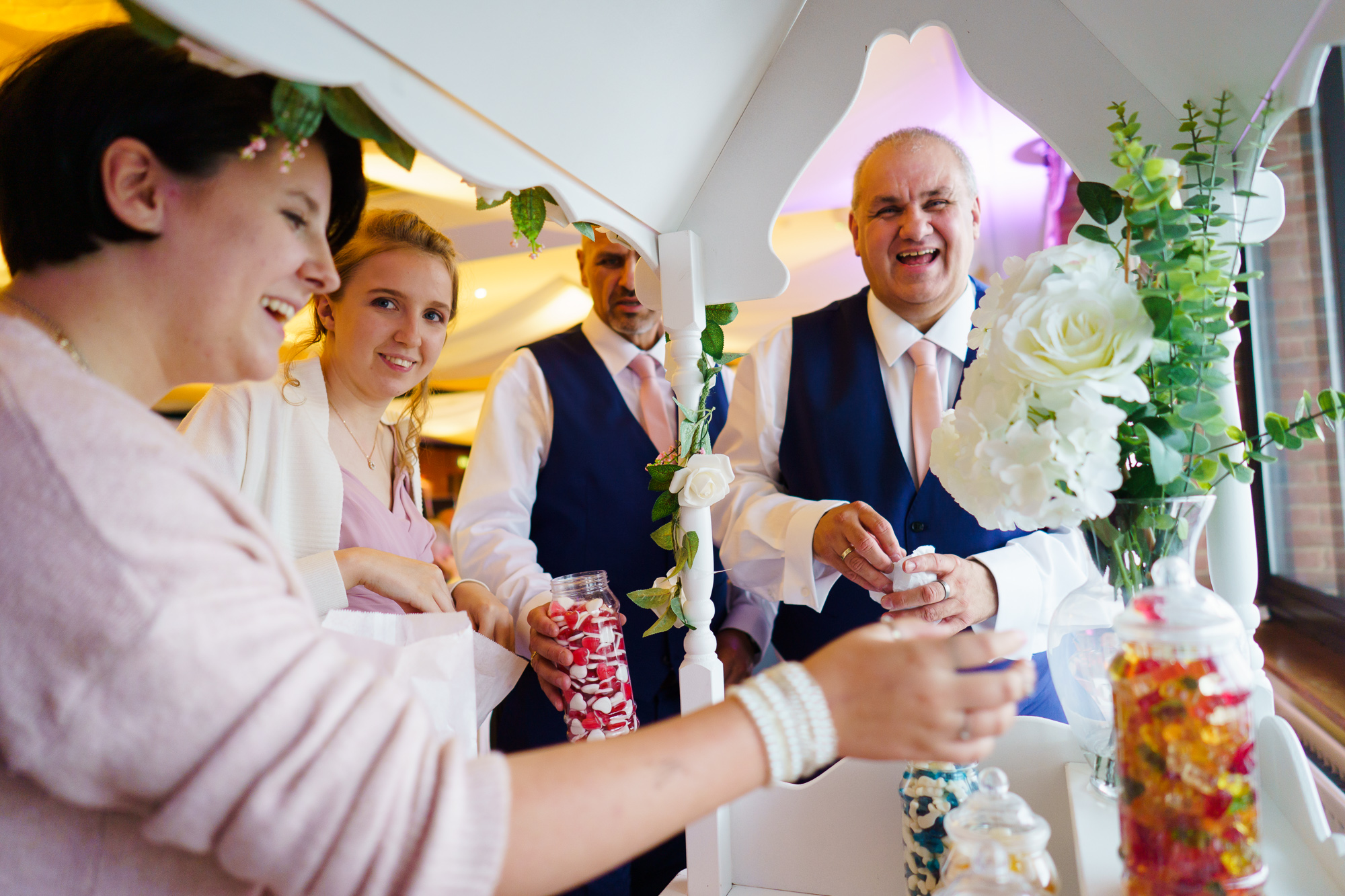 more guests raiding the sweetie cart at a wedding in roayl southern yacht club hamble le rice