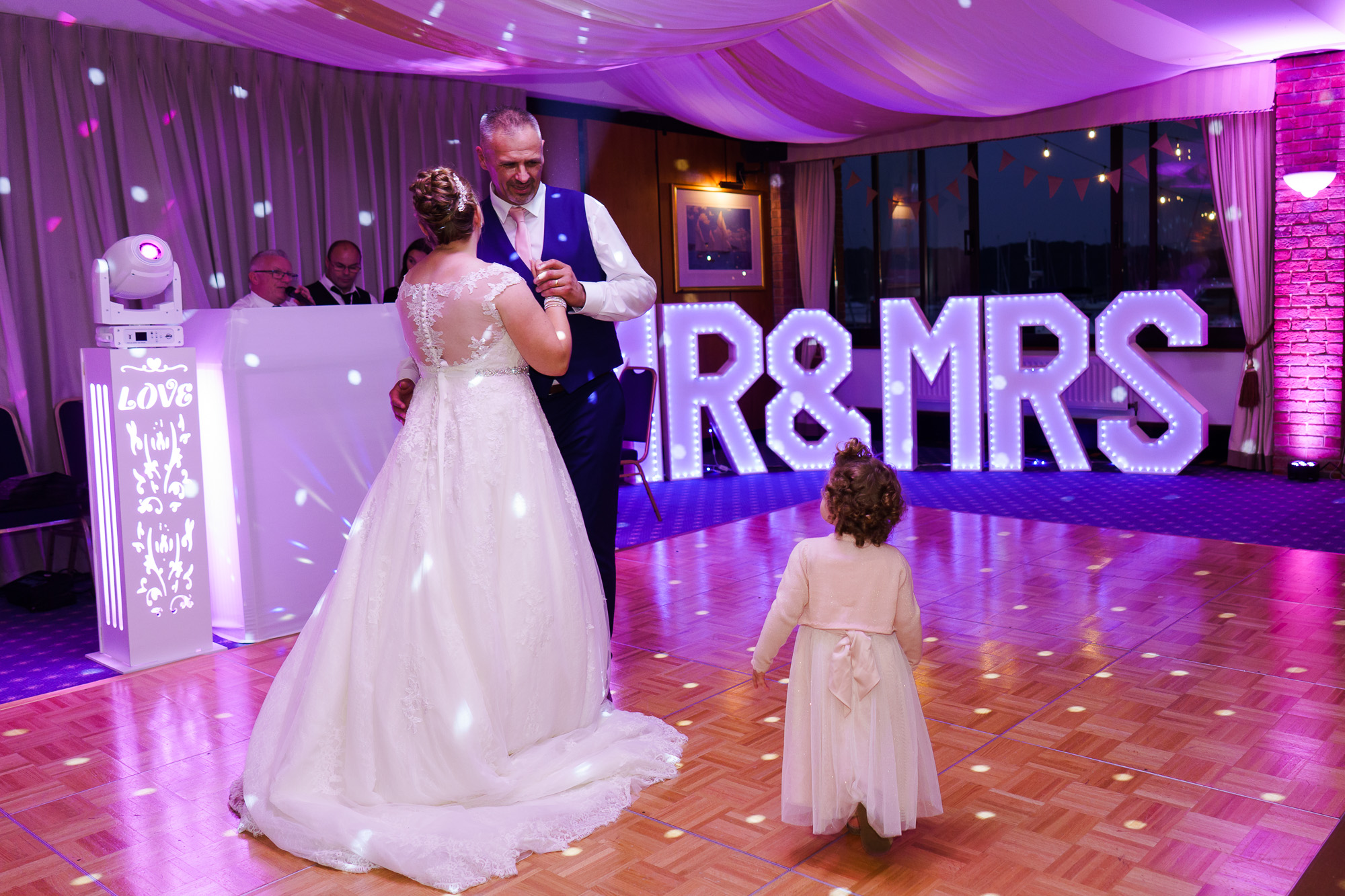 first dance of bride and groom and their daughter at royal southern yacht club
