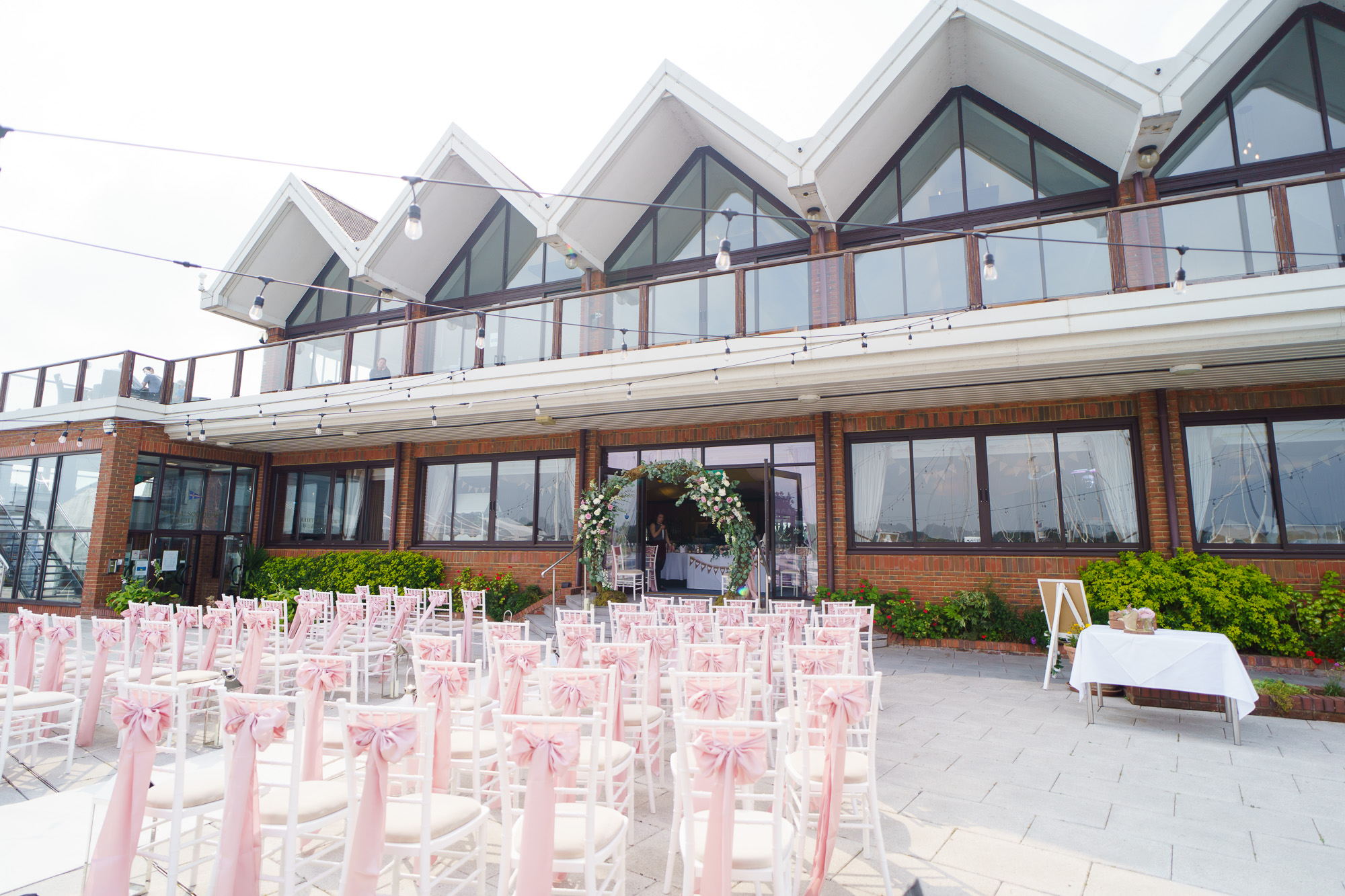 outdoor shot of royal southern yacht club hamble le rice wet up as wedding ceremony