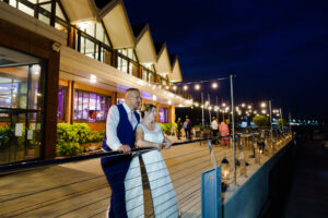 brdie and groom at twilight outside royal southern yacht club