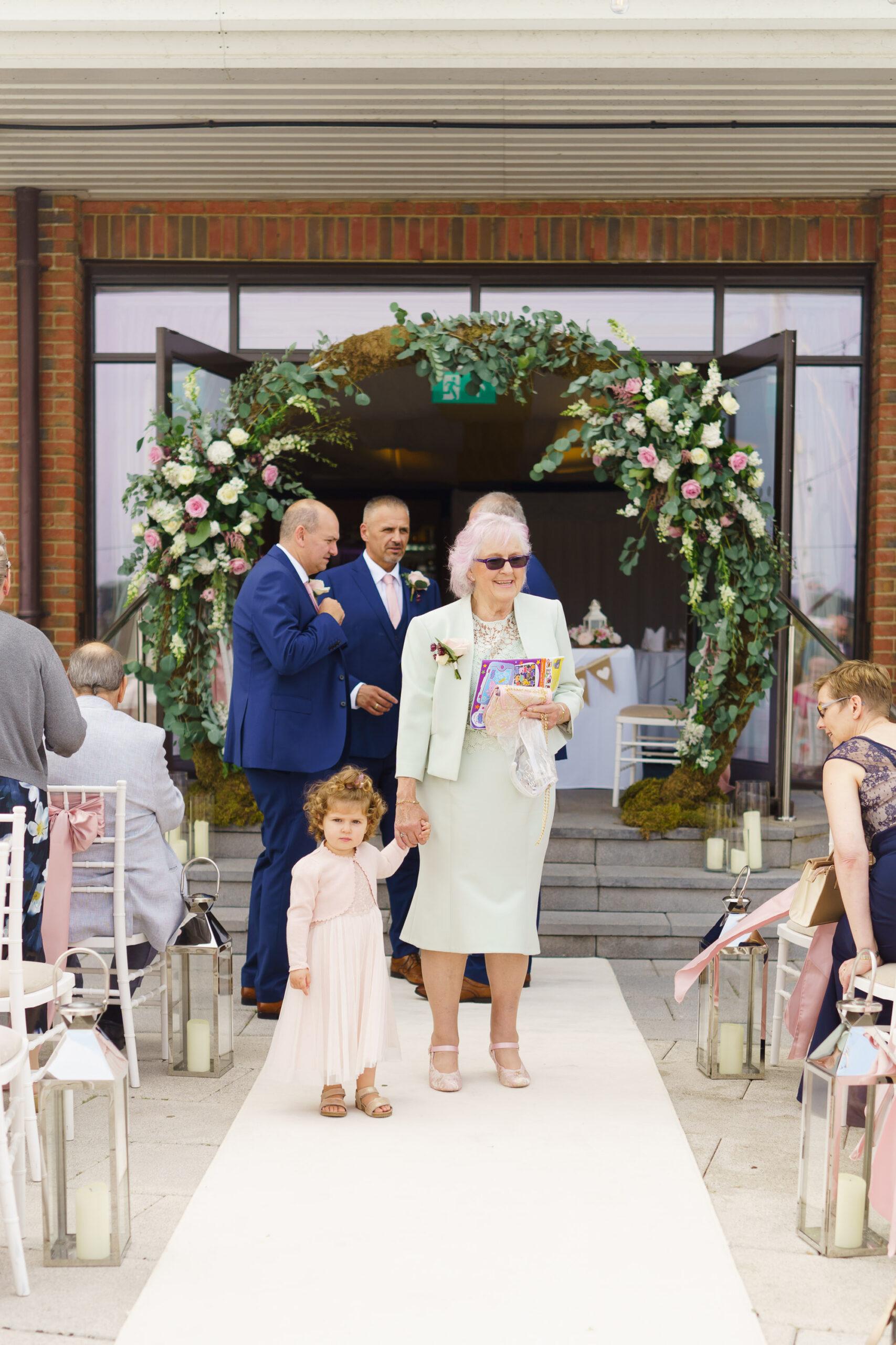 photo of grandma and toddler girl at wedding