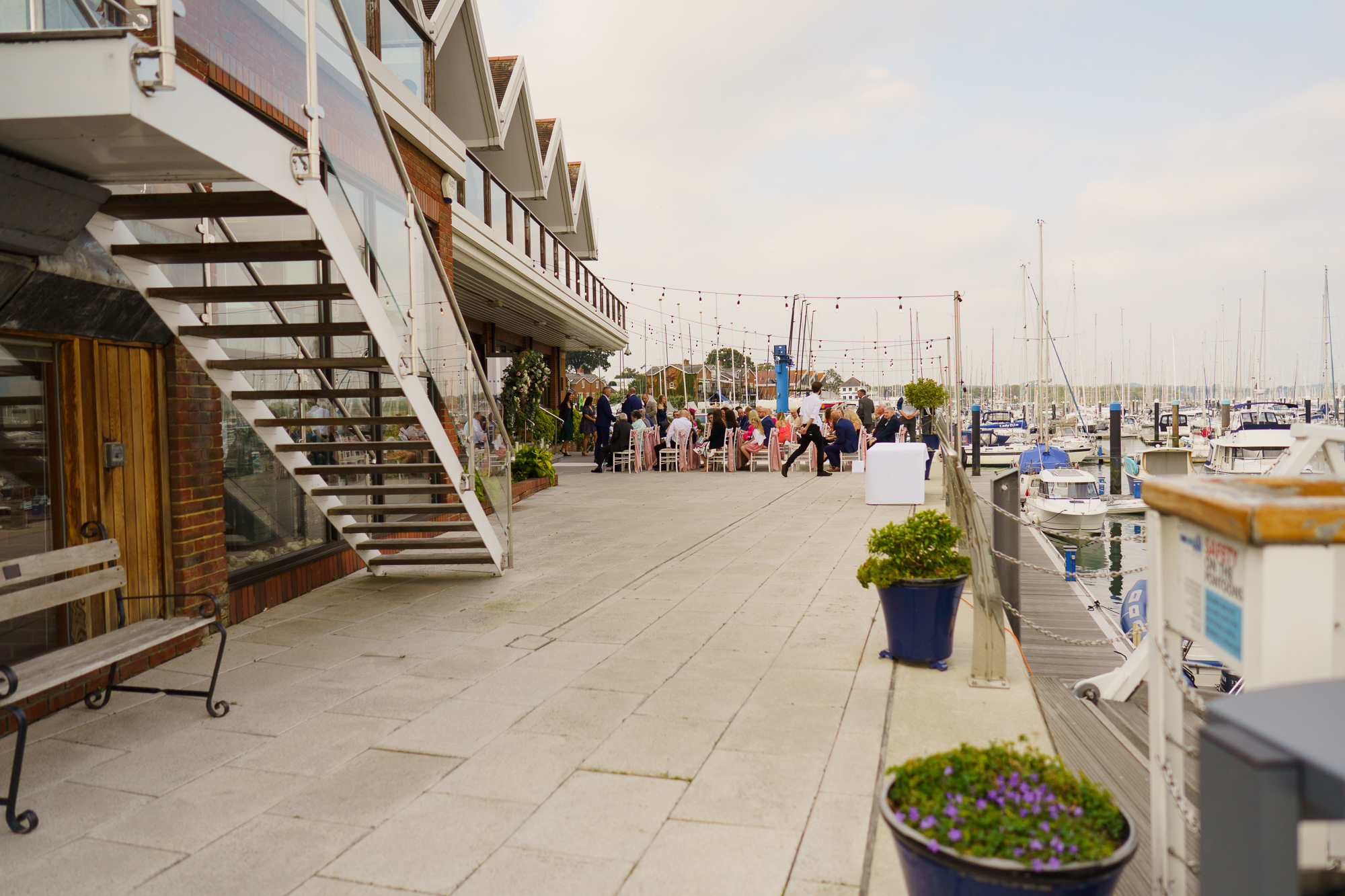 outdoor shot of wedding guests at roayl southern yacht club outdoor wedding