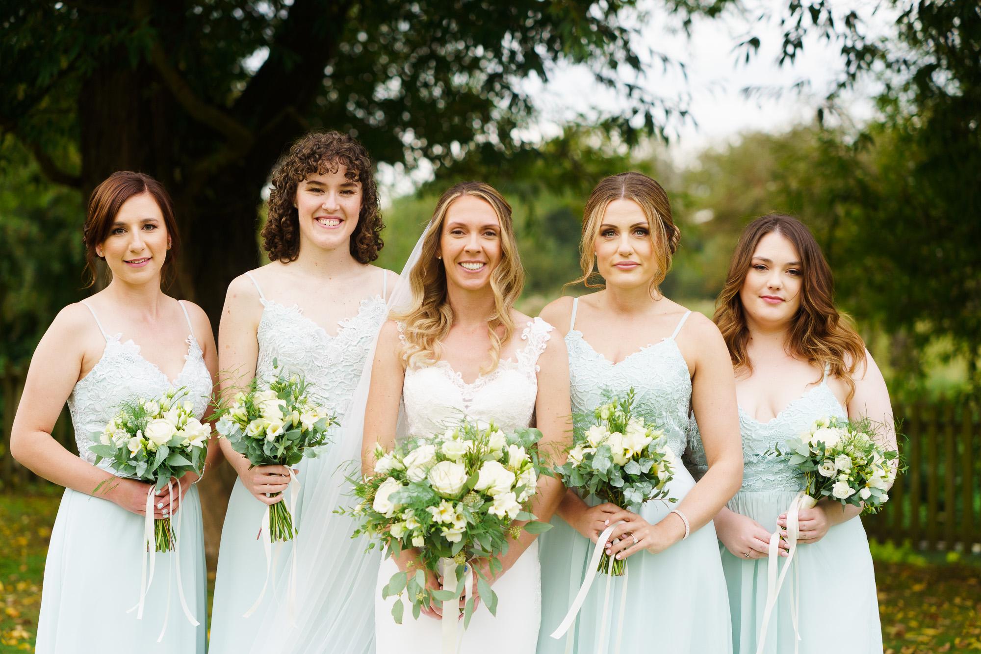 bride and bridesmaids at Sopley Mill