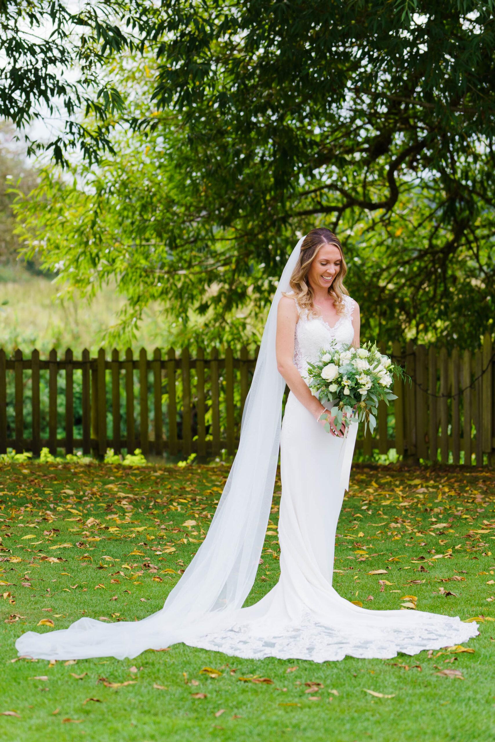 full length portrait of bride at Sopley Mill