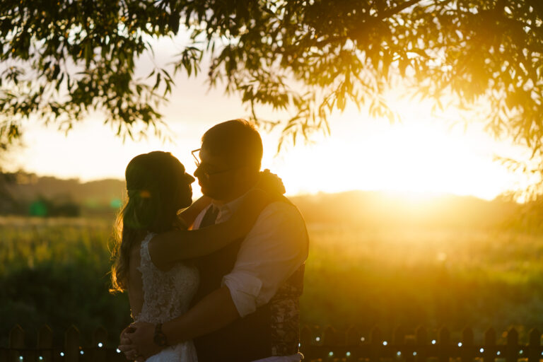 silhouette of bride and groom sunset photo