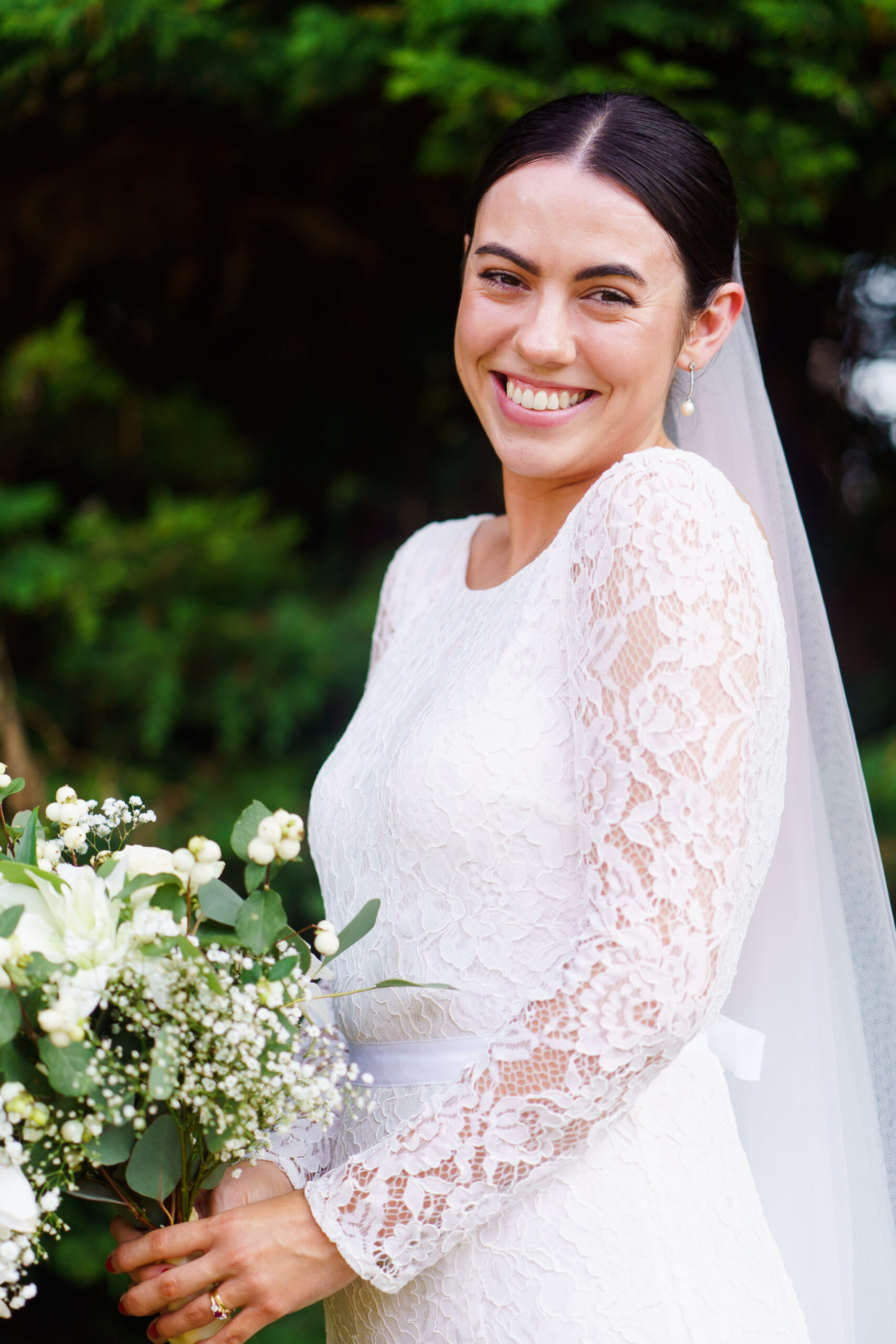 portrait of bride and lace dress outside bourne valley inn