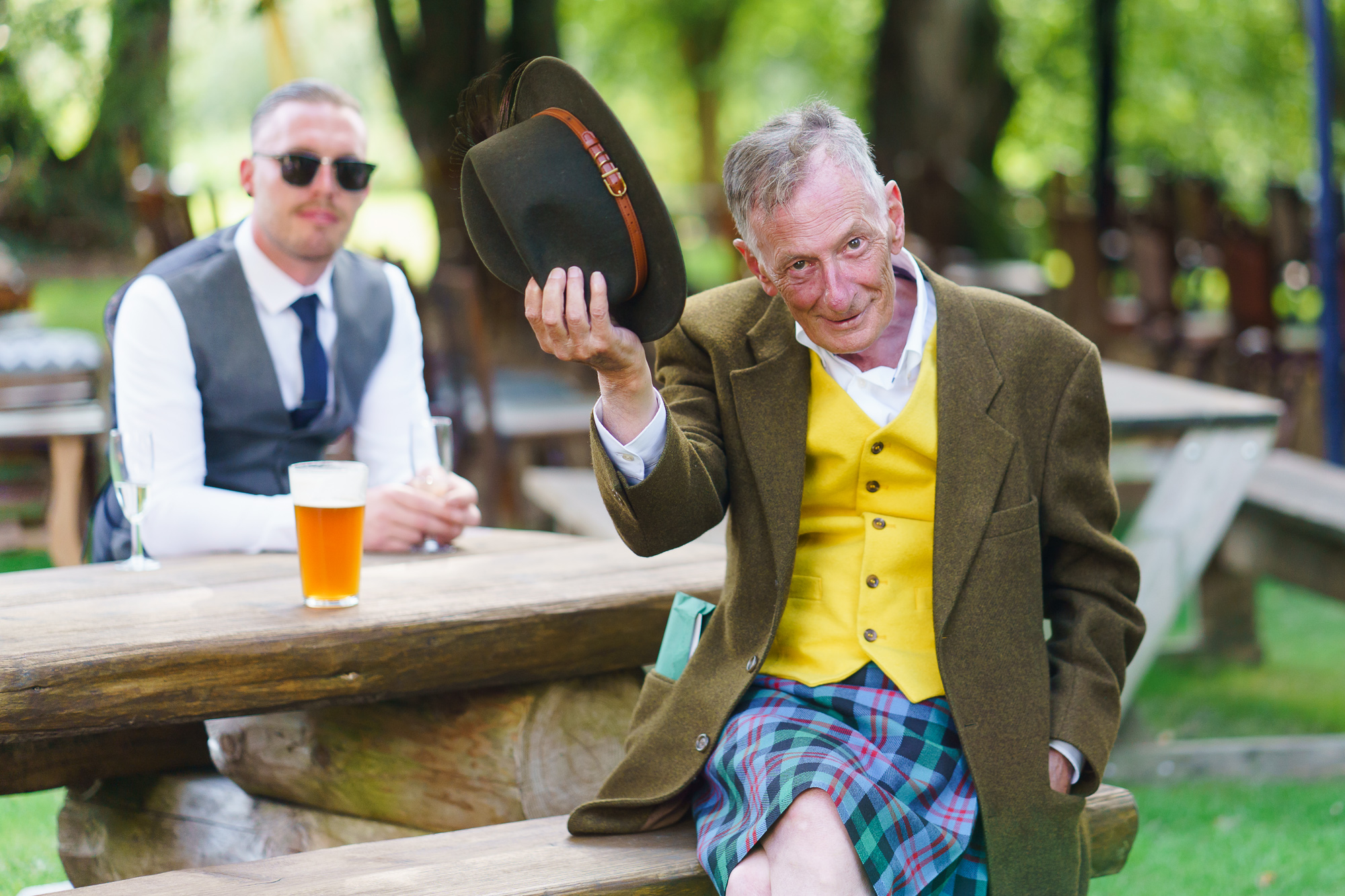 photo og guest tipping hat at wedding in Hampshire