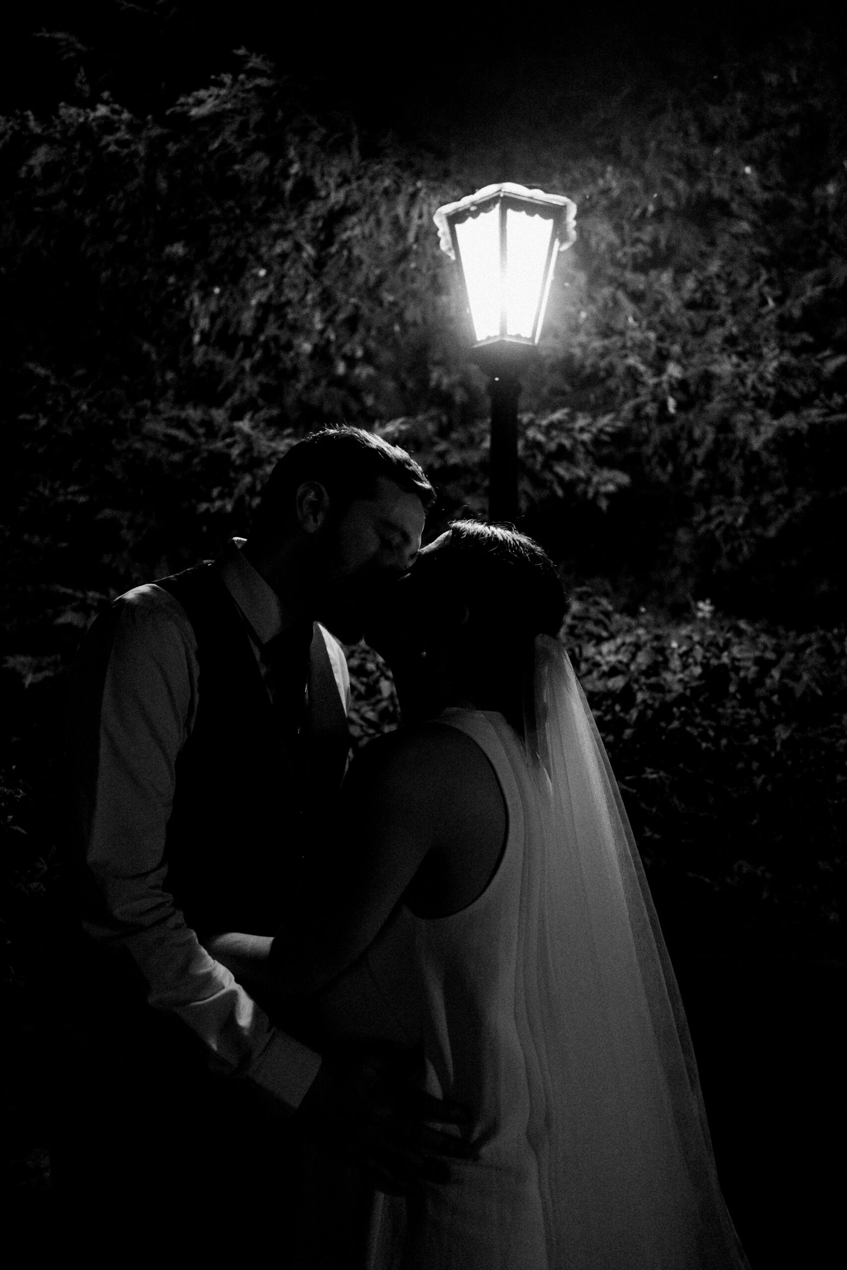 black and white protrait of bride and groom under lamplight bourne valley inn Hampshire