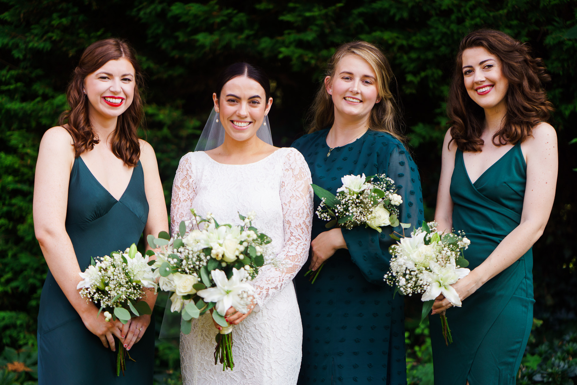 photo of bride and bridesmaids in green