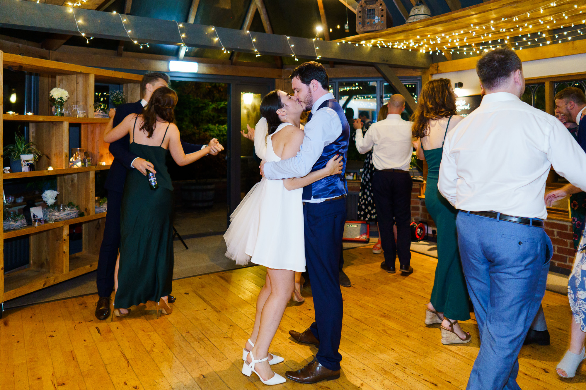 bride and groom kissing on dancefloor after first dance