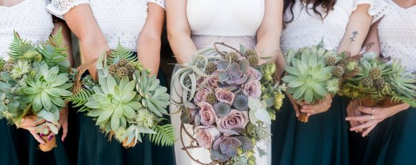 succulents wedding bouquets held by bride and bridesmaids in green